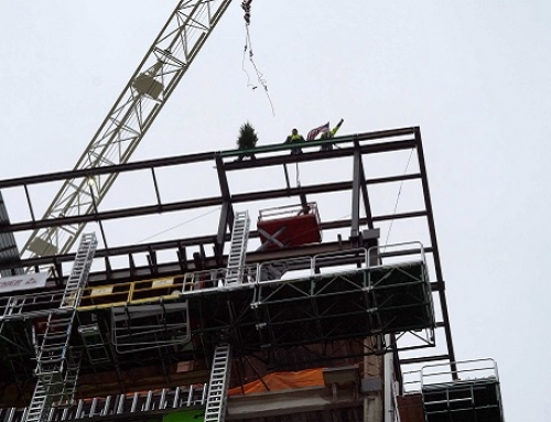 Last beam placed at top of new patient care tower